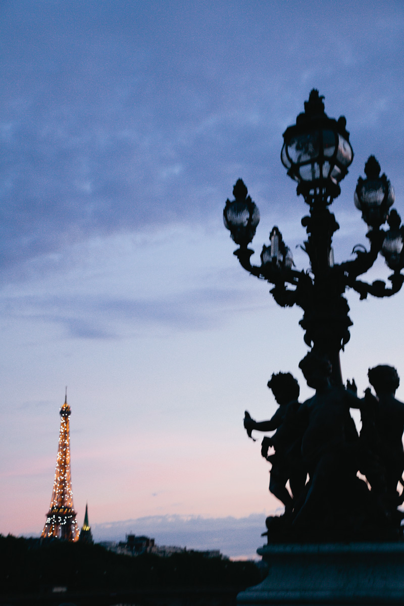 eiffel-tower-lights-up-summer-dusk-paris