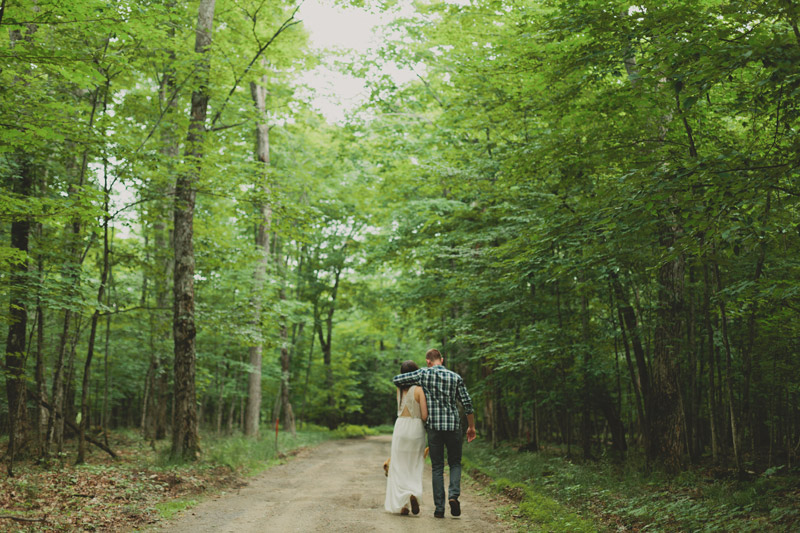 couple walking through forest engagement