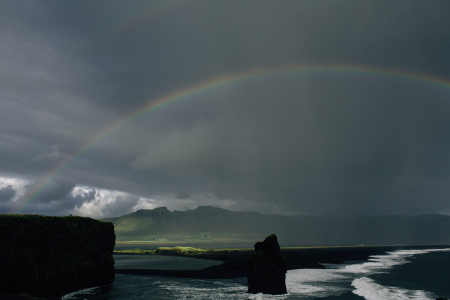 Black sand beach Iceland rainbow
