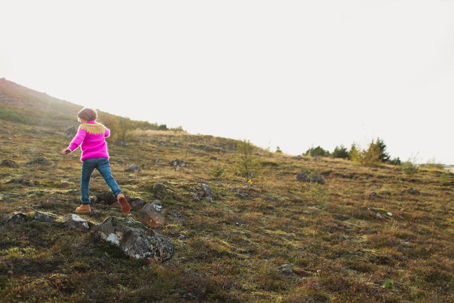 girl climbing hill